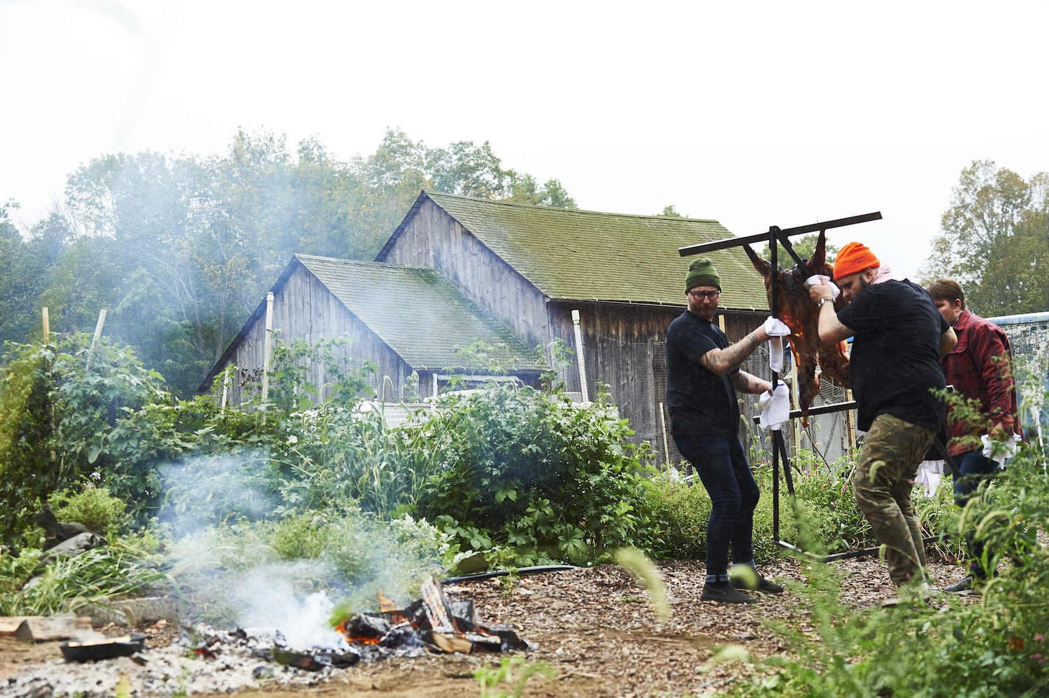 Christian Petroni of Fortina cooks an asado lamb over an open flame in Yonkers.